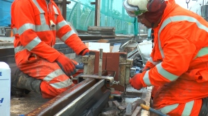 Builders weld the initial joining segment