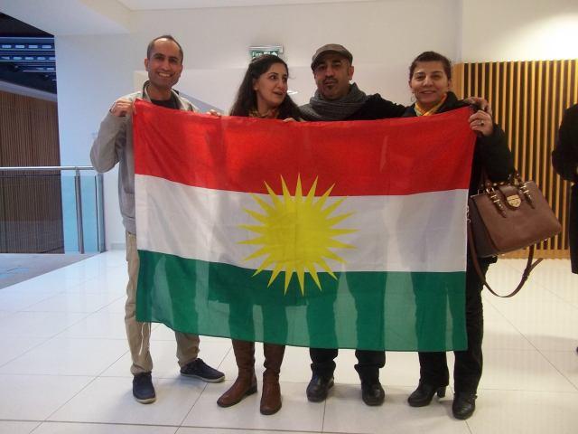 The organisers of Saturday's Kurdish education workshop pose  with a Kurdish flag
