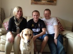 Nathan with his step-mum Michelle, dad Mick and guide dog Hudson